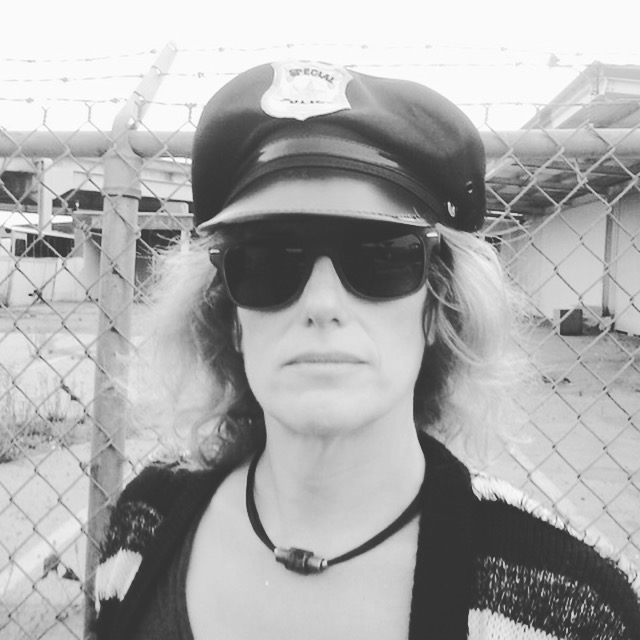 Debbie in a policeman's hat